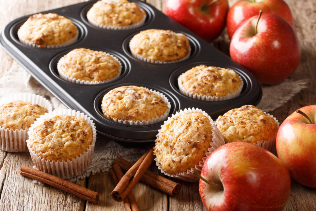 Sweet dessert apple muffins with cinnamon close-up in a baking dish on the table. horizontal