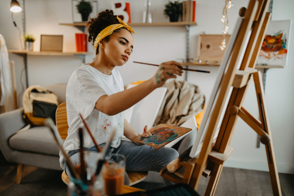 Photo of young female artist in her apartment