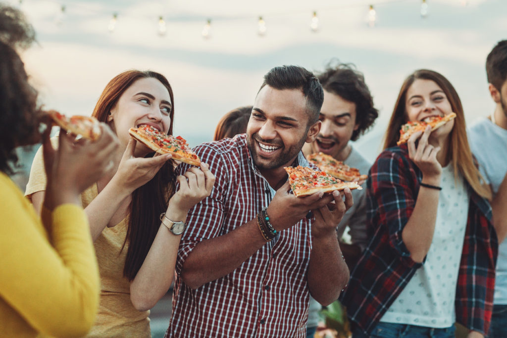 Group of friends eating pizza